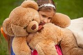 Photo Of Sad Little Girl Hugging Teddy Bear