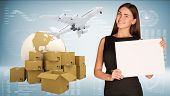 Businesswoman hold paper sheet. Earth with heap brown cardboard boxes and flying airplane are locate