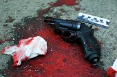 Gun and blood at crime scene