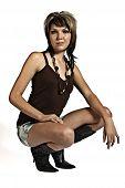 Beautiful young woman kneeling