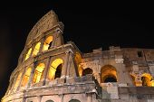 Majestic ancient Colosseum by night in Rome, Italy