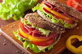 image of salami  - healthy sandwich with salami tomato pepper and lettuce - JPG
