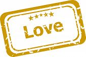 Red Grunge Rubber Stamp With The Word Love Written Inside The Stamp