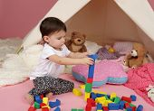 Child Play: Pretend  Play With Blocks And Teepee Tent
