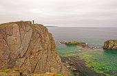 Observer On A Rocky Ocean Coast