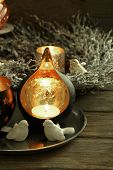 Composition with beautiful candlesticks, Christmas wreath and other decorations for home interior, on dark wooden background