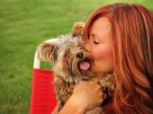 pic of cuddle  -  a woman with her beautiful dog cuddling outside at a park  - JPG