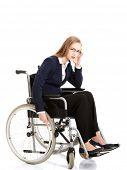 Tired caucasian businesswoman on a wheelchair