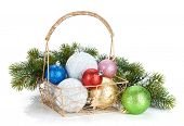 Colorful christmas baubles and fir tree. Isolated on white background