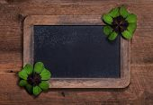 Rustic country style wooden background or billboard with two four-leaf clovers.