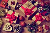 foto of wooden table  - a pile of gifts and christmas ornaments - JPG
