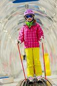 Skiing, young skier on ski lift, ski moving walkway