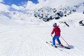 Skiing, winter sport - child skiing downhill