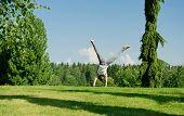 Young woman doing cartwheel outside