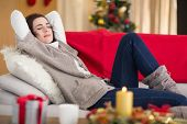 Brunette napping on the couch at christmas at home in the living room