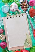 picture of recipe card  - Notepad for recipes and aromatic spices on the table - JPG