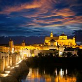 Famous Mosque (Mezquita) and  Roman Bridge at beautifu night sky with illuminations, Cordoba, Andalusia, Spain, Europe