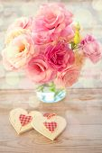 Love Vintage Background - Beautiful Eustoma  Flowers and Two Hearts, light defocused