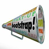 Bootstrap word and related words on a megaphone or bullhorn including self funded, business, building, invest, capital, finance, entrepreneur and savings
