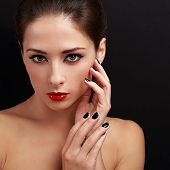 Beautiful Makeup Model Looking With Short Black Finger Nails And Red Lipstick