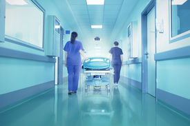 stock photo of forgiveness  - Bright lights at the end the hospital corridor. The concept of life and death.