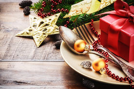 image of dinner invitation  - Christmas table setting in gold and red tone - JPG