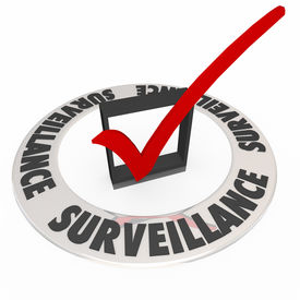 image of wiretap  - Surveillance word in ring around check box and mark to illustrate safety and security precautions taken to monitor for crime or criminal activity - JPG