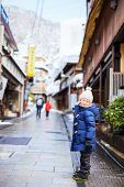 picture of japan girl  - Little girl at old district of hot spring resort town Shibu onsen in Japan on winter day - JPG