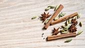 foto of cardamom  - star anise cinnamon stick and cardamom on a wooden background - JPG