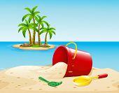 stock photo of bucket  - Bucket on the sand near the ocean - JPG
