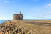 pic of papagayo  - Small castle Castillo de las Coloradas on cliff in Playa Blanca Lanzarote Canary Islands Spain - JPG