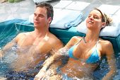 image of tub  - Young couple relaxing in hot tub - JPG