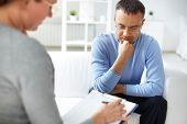 stock photo of psychologist  - Man sharing problems with psychologist - JPG