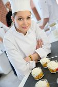 stock photo of confectioners  - Closeup of smiling young pastry confectioner - JPG