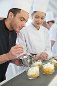 foto of pastry chef  - Chef with student in pastry making dessert - JPG