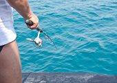 picture of fly rod  - an image of man with rod - JPG