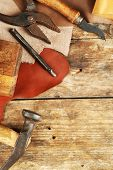 stock photo of leather tool  - Leather and craft tools on wooden background - JPG