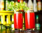 foto of bloody mary  - Couple of Bloody Mary cocktails on a bar in nightclub - JPG