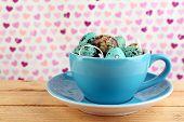 image of bird egg  - Bird colorful eggs in mug on bright background - JPG