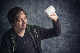 image of disappointed  - Disappointed Man Looking at Empty Cup Concept of Failure of Expectations - JPG
