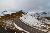 foto of snow capped mountains  - Mountain pass high alpine road on the background of snow - JPG