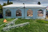 stock photo of canopy  - White canopy with four windows and a white picket fence in grass field - JPG