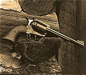 stock photo of sixgun  - a western style revolver in a western setting - JPG