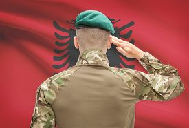 stock photo of albania  - Soldier in hat facing national flag series  - JPG
