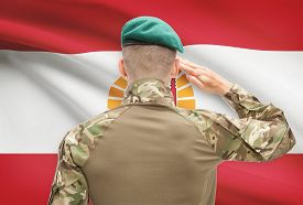 picture of french polynesia  - Soldier in hat facing national flag series  - JPG