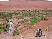 Moroccan Man Praying In A Mountain Oasis, Ait Benhaddou Ksar, Ouarzazate, Morocco
