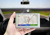 stock photo of gps navigation  - GPS VEHICLE NAVIGATION SYSTEM IN A MAN HAND - JPG
