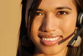 Attractive smiling telephone technical  support woman.