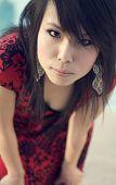 Attractive pretty impish cute Asian woman with blue color tone