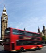 Big Ben - famous clock tower in City of Westminster, part of London with typical red double decker in foreground